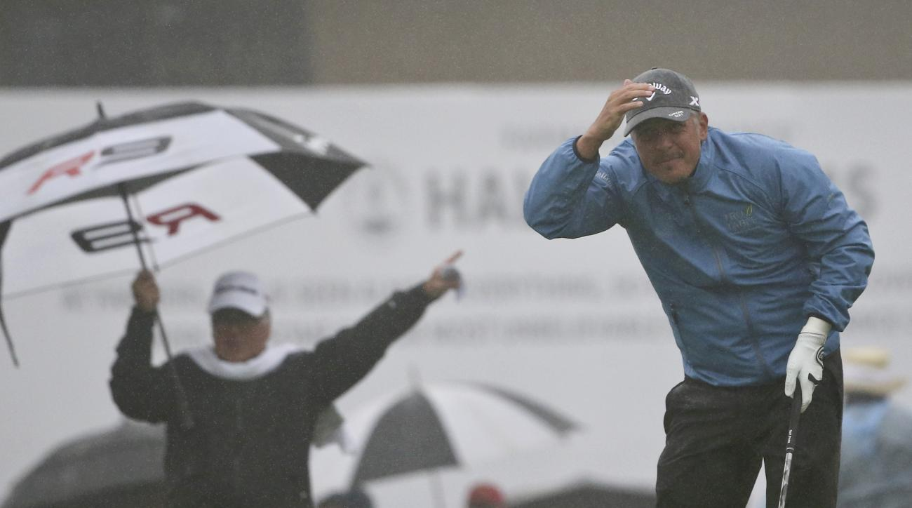 Freddie Jacobson, from Sweden, tries to follow the flight of his tee shot through the rain on the first hole of the South Course at Torrey Pines during the final round of the Farmers Insurance Open golf tournament  Sunday, Jan. 31, 2016, in San Diego.  Th
