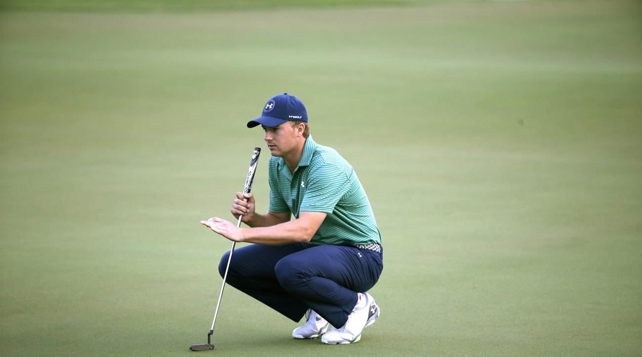 Jordan Spieth of the United States checks the green of the 18th hole during the final round of the SMBC Singapore Open golf tournament at Sentosa Golf Club's Serapong Course on Monday, Feb. 1, 2016, in Singapore. (AP Photo/Wong Maye-E)