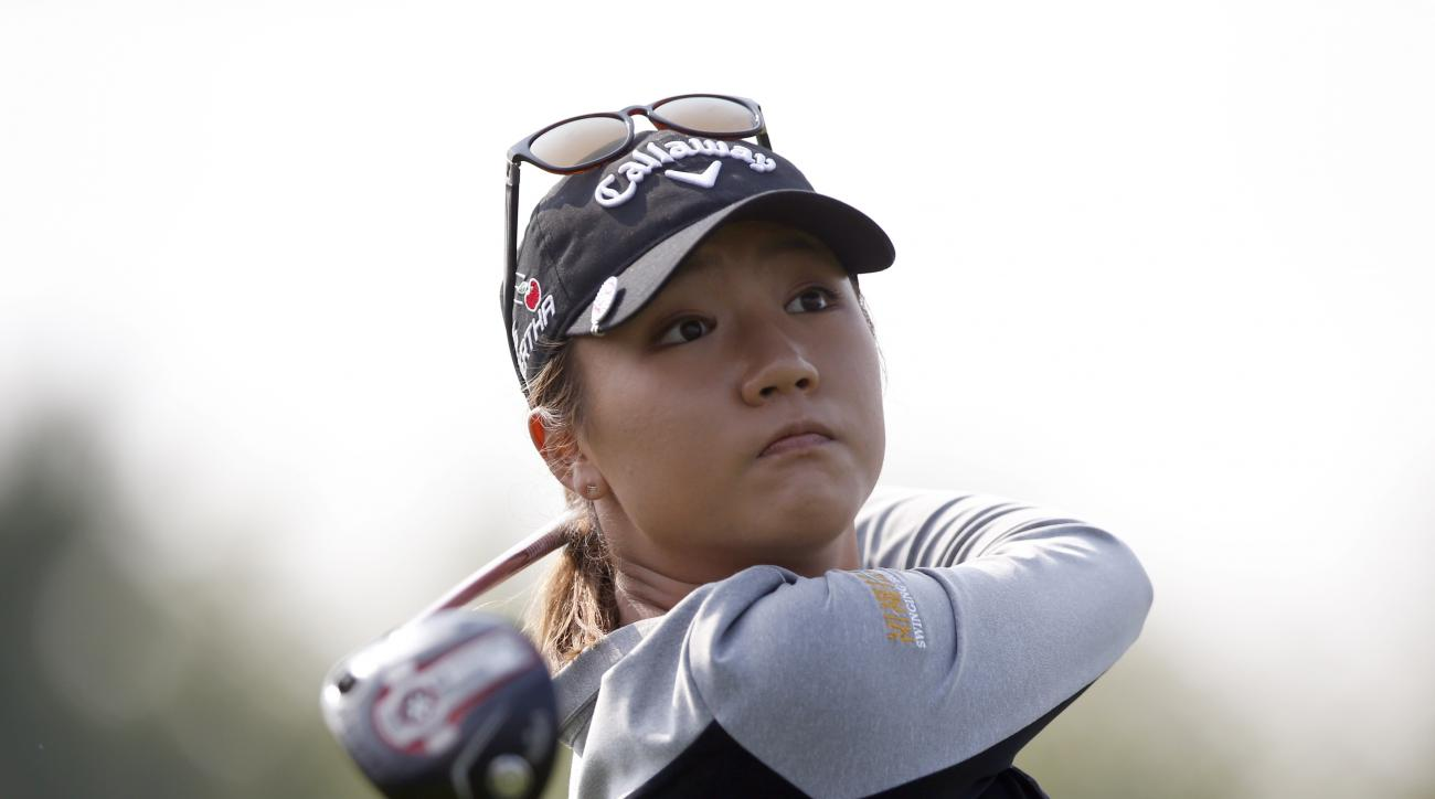 Lydia Ko of New Zealand watches her shot on the second hole during the final round of the LPGA KEB Hana Bank Championship golf tournament at Sky72 Golf Club in Incheon, South Korea, Sunday, Oct. 18, 2015. (AP Photo/Lee Jin-man)