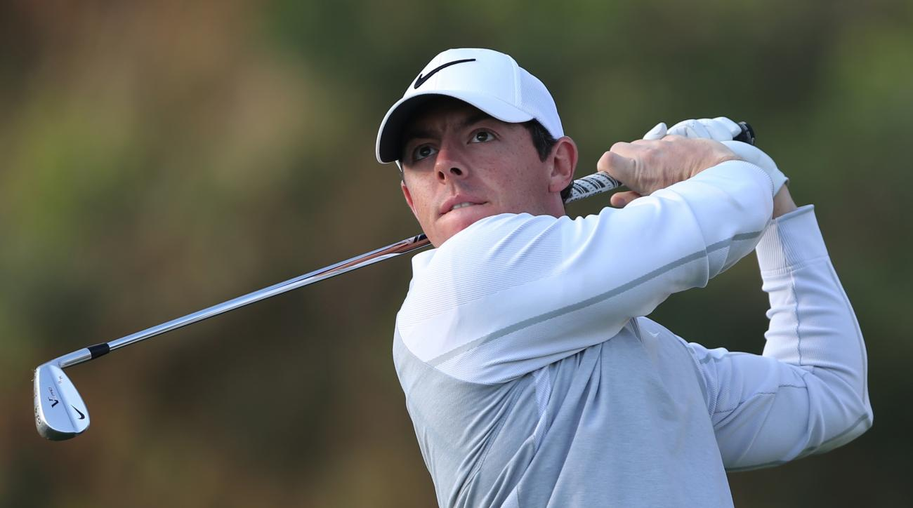 Rory McIlroy of Northern Ireland follows his ball on the 11th hole during 1st round of the Omega Dubai Desert Classic golf tournament in Dubai, United Arab Emirates, Thursday, Feb. 4, 2016. (AP Photo/Kamran Jebreili)