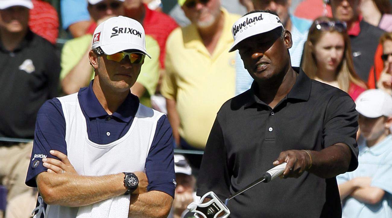 Vijay Singh, right, of Fiji, talks with caddie David Renwick on the sixth hole during the third round of the BMW Championship PGA golf tournament at Crooked Stick Golf Club in Carmel, Ind., Saturday, Sept. 8, 2012. (AP Photo/Charles Rex Arbogast)