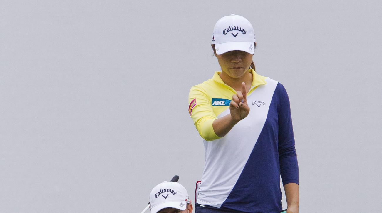 Lydia Ko lines up her putt on the 18th green during the second round of the Coates Golf Championship LPGA tournament at Golden Ocala on Thursday, Feb. 4, 2016, in Ocala, Fla. The second round was suspended because of thunderstorms in the area. (Doug Engle