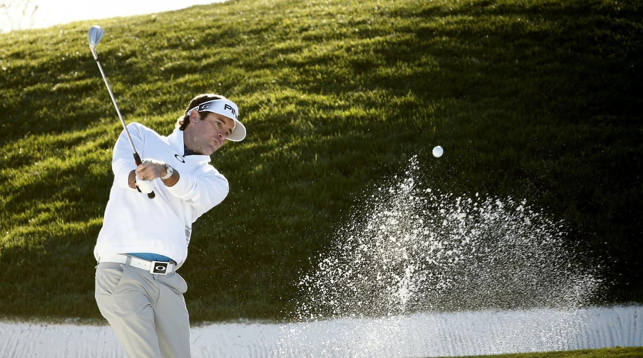 Bubba Watson hits out of a bunker on the 12th hole during the second round of the Waste Management Phoenix Open golf tournament at TPC Scottsdale in Scottsdale, Ariz., on Friday, Feb. 5, 2016.  (Rob Schumacher/The Arizona Republic via AP)