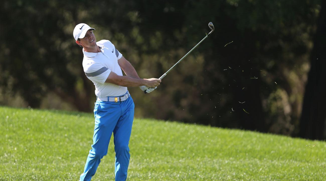 Rory McIlroy of Northern Ireland plays a shot on the 2nd hole  during 3rd round of the Dubai Desert Classic golf tournament in Dubai, United Arab Emirates, Saturday, Feb. 6, 2016. (AP Photo/Kamran Jebreili)