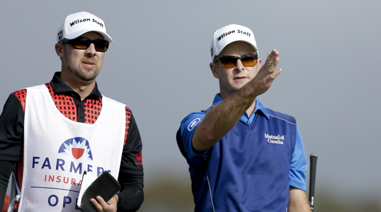 Kevin Streelman, right, gestures alongside his caddie before his tee shot on the second hole during the third round of the Farmers Insurance Open golf tournament, Saturday, Jan. 30, 2016, in San Diego. (AP Photo/Gregory Bull)