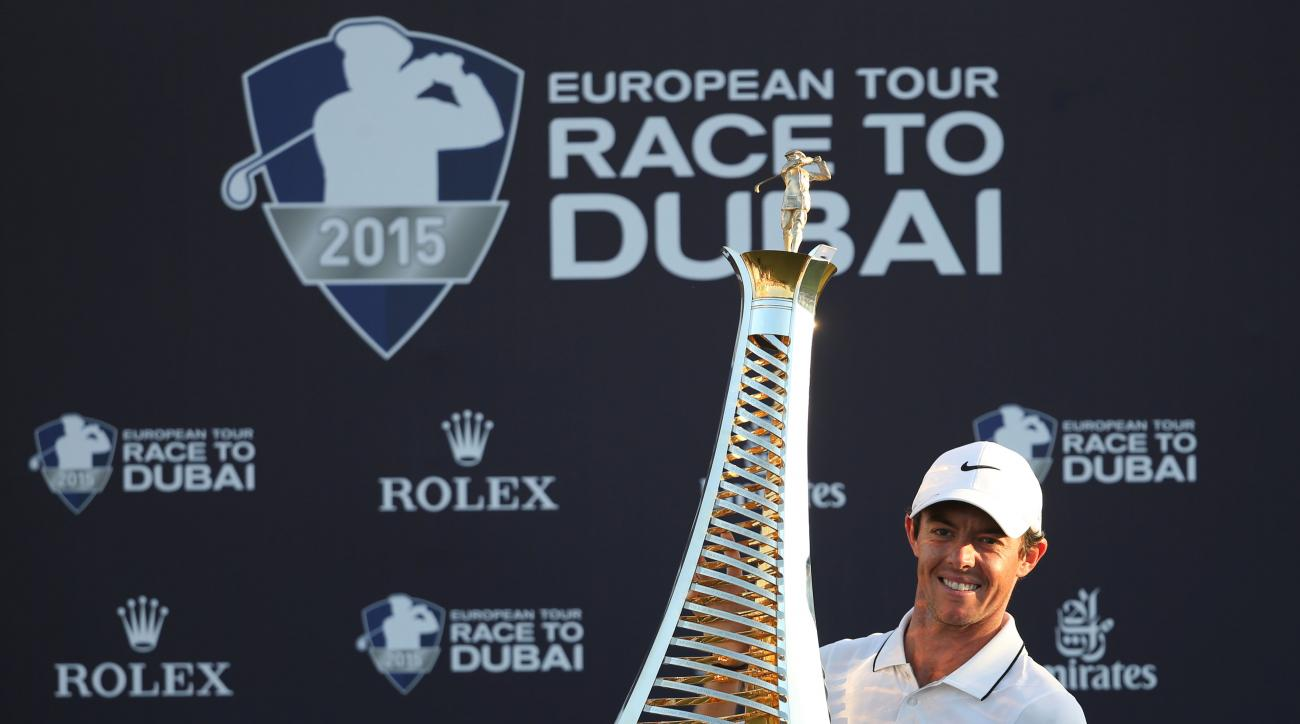FILE - In this Sunday Nov. 22, 2015 file photo, Rory McIlroy of Northern Ireland poses with the Race to Dubai trophy after winning the final round of DP World Tour Championship golf tournament in Dubai, United Arab Emirates. Rory McIlroy has been voted as