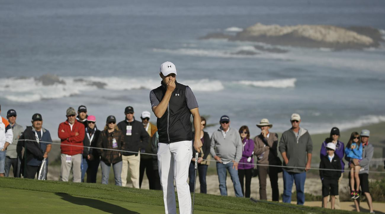 Jordan Spieth reacts after missing a birdie putt on the second green of the Spyglass Hill Golf Course during the first round of the AT&T Pebble Beach National Pro-Am golf tournament Thursday, Feb. 11, 2016, in Pebble Beach, Calif. (AP Photo/Eric Risberg)