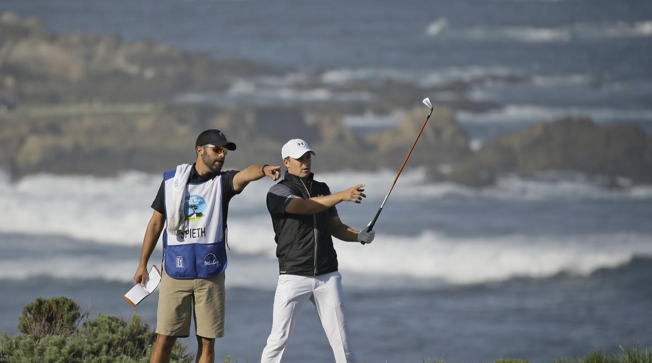 Jordan Spieth, right, stands with his caddie, Michael Greller, left, before hitting from the fourth tee of the Spyglass Hill Golf Course during the first round of the AT&T Pebble Beach National Pro-Am golf tournament Thursday, Feb. 11, 2016, in Pebble Bea