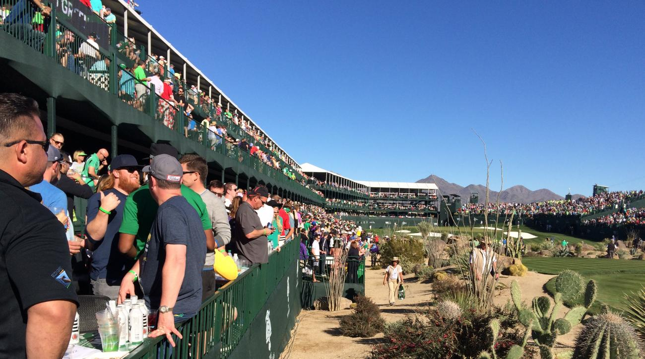 In this Saturday, Feb. 5, 2016, photo, people gather in the grandstand on the 16th hole at TPC Scottsdale, during the third round of the Phoenix Open golf tournament in Scottsdale, Ariz. A picturesque par-3 for 51 weeks, No. 16 at TPC Scottsdale transform