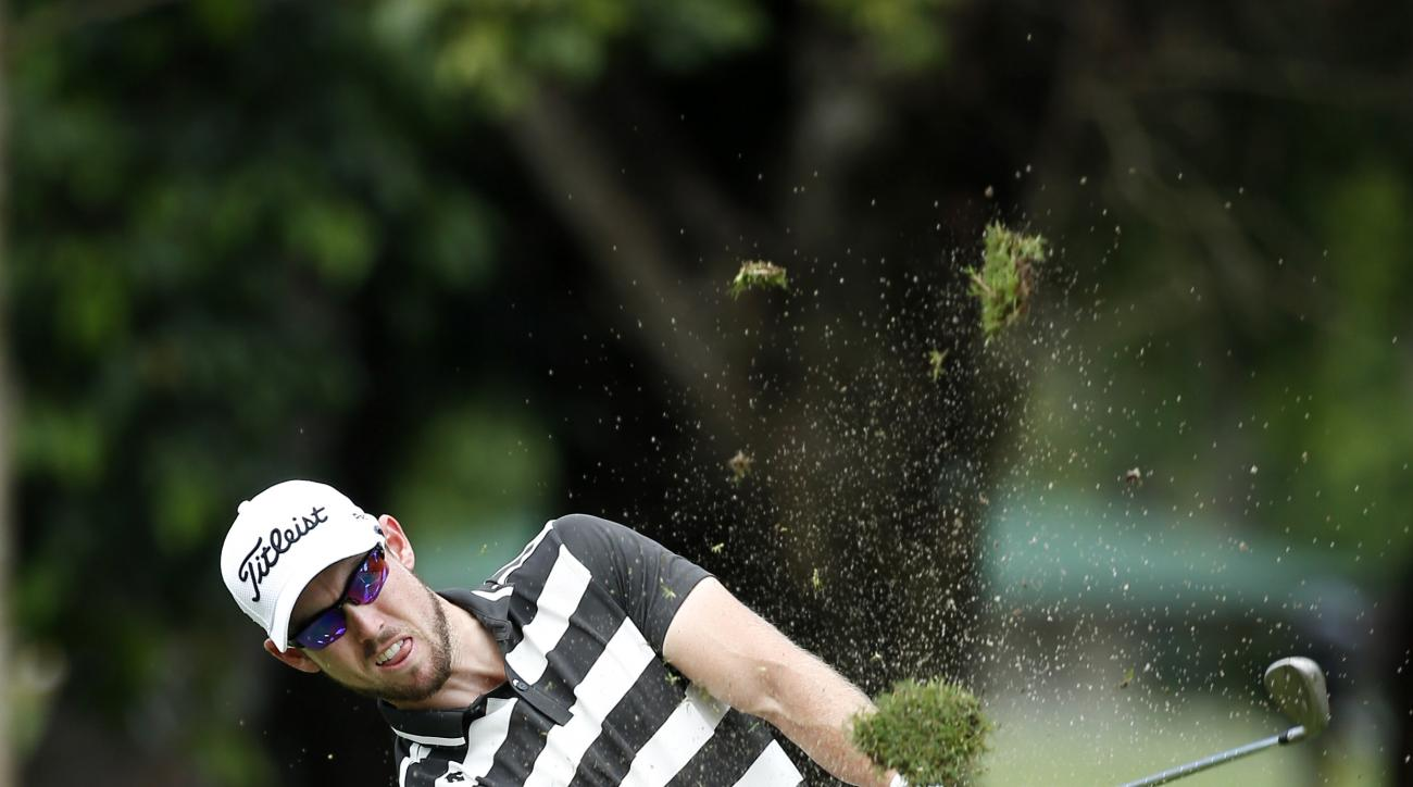 Nathan Holman of Australia hits a shot during day two of the Maybank Championship golf tournament in Kuala Lumpur, Malaysia, Friday, Feb. 19, 2016. (AP Photo/Vincent Thian)