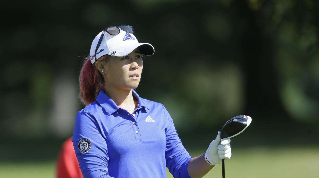 Danielle Kang watches her drive on the ninth hole during the second round of the Meijer LPGA Classic golf tournament at Blythefield Country Club, Friday, July 24, 2015 in Belmont, Mich. (AP Photo/Carlos Osorio)