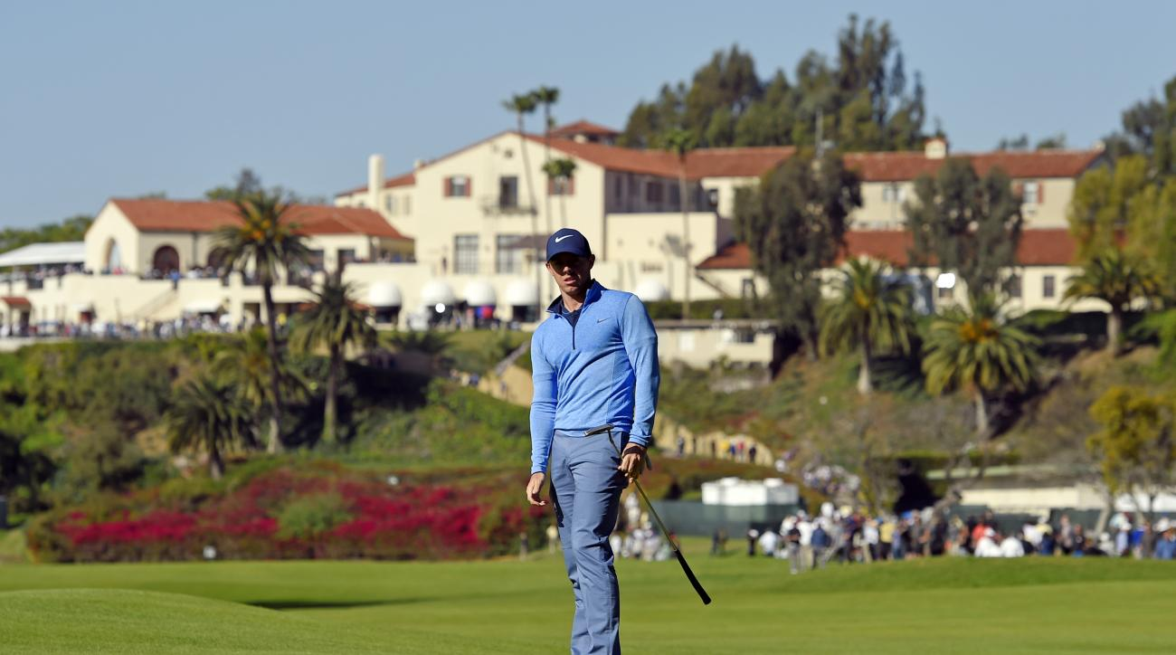 Rory McIlroy, of Northern Ireland, misses a long putt on the first green in the third round of the Northern Trust Open golf tournament, Saturday, Feb. 20, 2016, in the Pacific Palisades section of Los Angeles. (AP Photo/Mark J. Terrill)