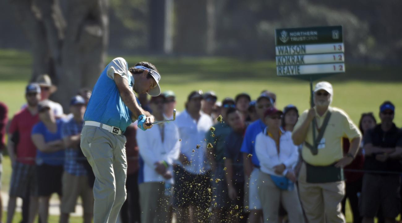 Bubba Watson makes his approach shot on the second fairway in the fourth round of the Northern Trust Open golf tournament, Sunday, Feb. 21, 2016, in the Pacific Palisades section of Los Angeles. (AP Photo/Mark J. Terrill)
