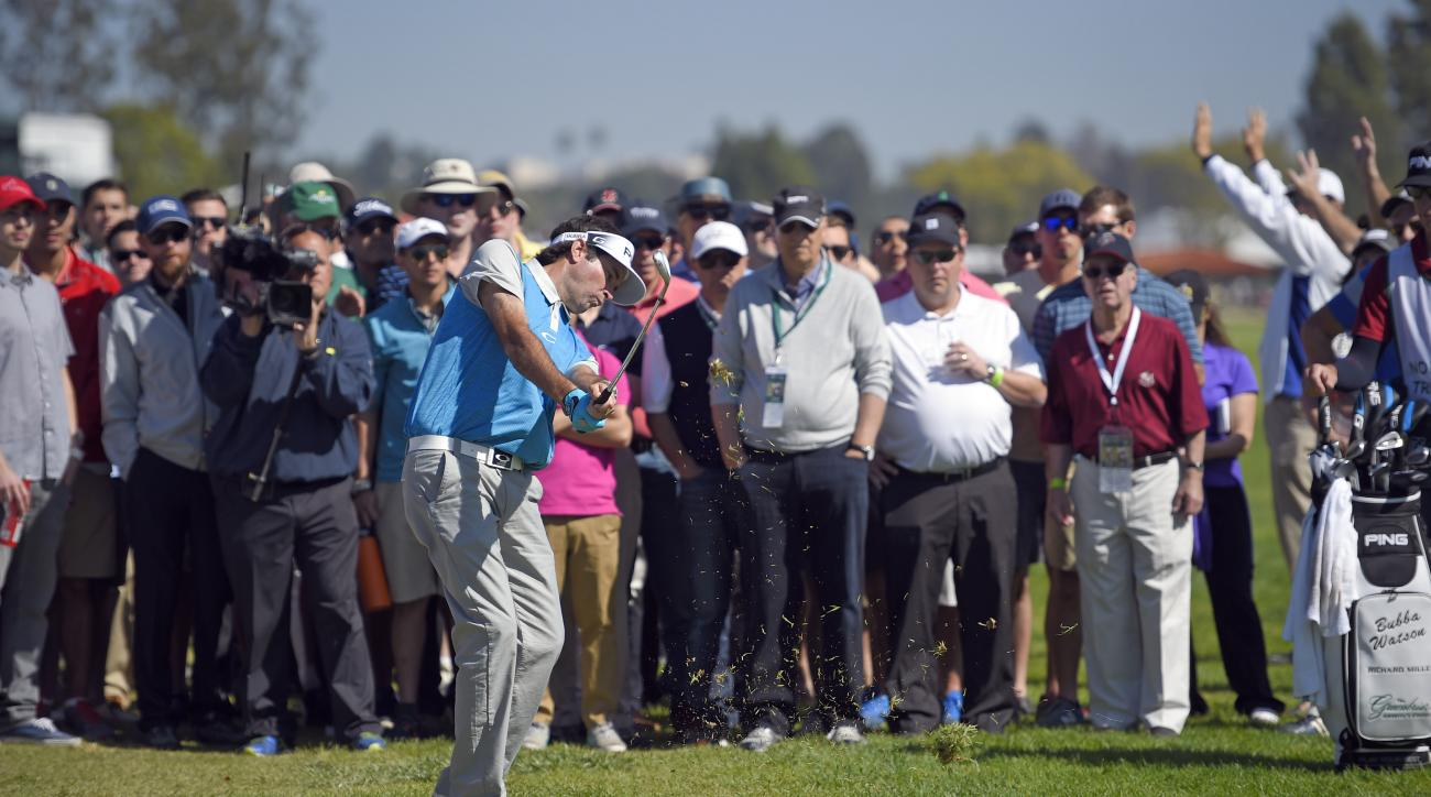 Bubba Watson hits from the crowd on the third fairway in the fourth round of the Northern Trust Open golf tournament, Sunday, Feb. 21, 2016, in the Pacific Palisades section of Los Angeles. (AP Photo/Mark J. Terrill)