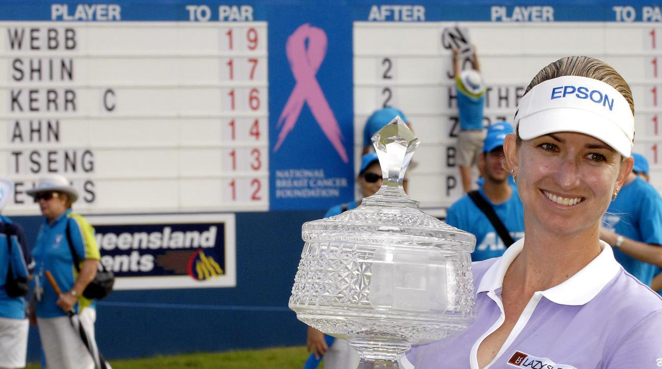 Australian golfer Karrie Webb holds the winners trophy after the final round of the Ladies Masters at Royal Pines golf course on the Gold Coast, Australia, Sunday Feb 11, 2007. Webb finished with a score of 19 under par. (AP Photo/Steve Holland)