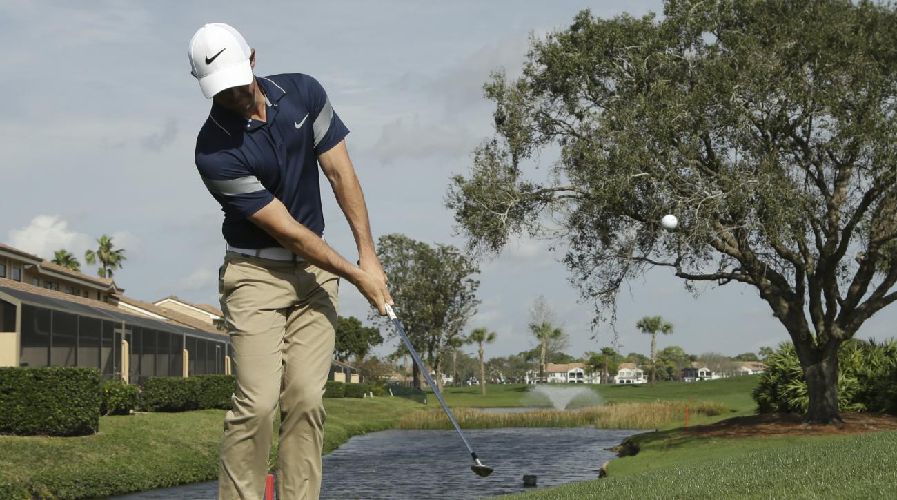 Rory McIlroy, of Northern Ireland, chips onto the 12th green during the Pro-Am of the Honda Classic golf tournament, Wednesday, Feb. 24, 2016, in Palm Beach Gardens, Fla. (AP Photo/Lynne Sladky)