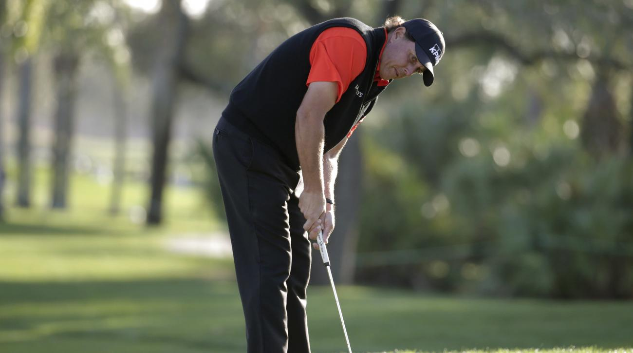 Phil Mickelson putts for a birdie on the 10th green during the first round of the Honda Classic golf tournament, Thursday, Feb. 25, 2016, in Palm Beach Gardens, Fla. (AP Photo/Lynne Sladky)
