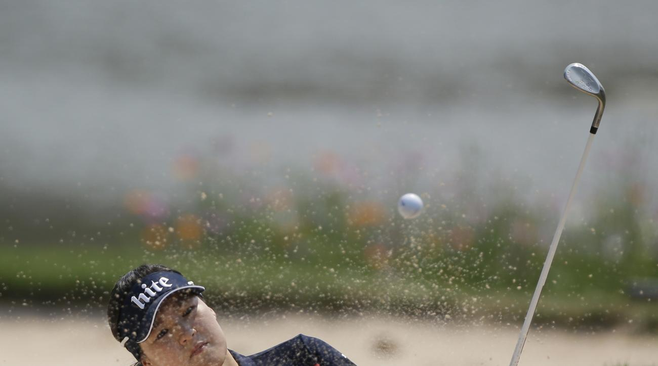In Gee Chun of South Korea hits the ball from bunker on the 8th hole during the final round of the LPGA Thailand golf tournament in Pattaya, southern Thailand, Sunday, Feb. 28, 2016. (AP Photo/Sakchai Lalit)