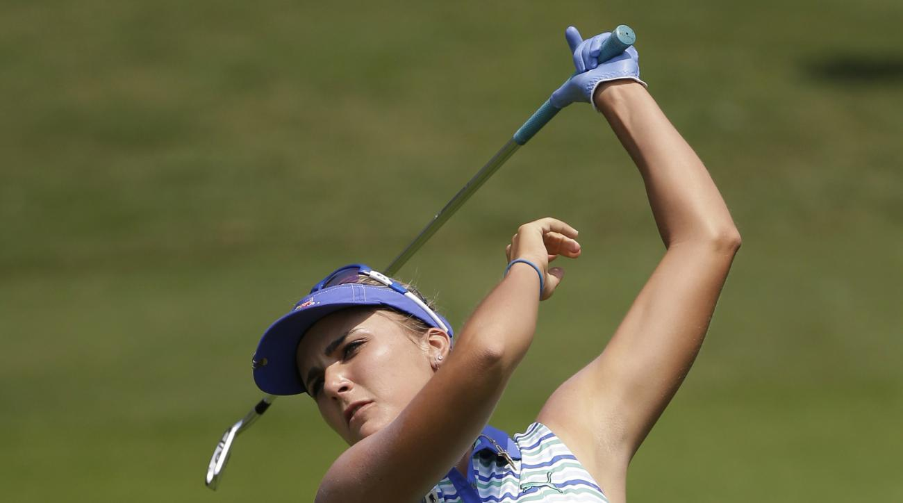Lexi Thomson of the United States, watches her ball from a shot from a fairway on 1st hole during the final round of the LPGA Thailand golf tournament in Pattaya, southern Thailand, Sunday, Feb. 28, 2016. (AP Photo/Sakchai Lalit)
