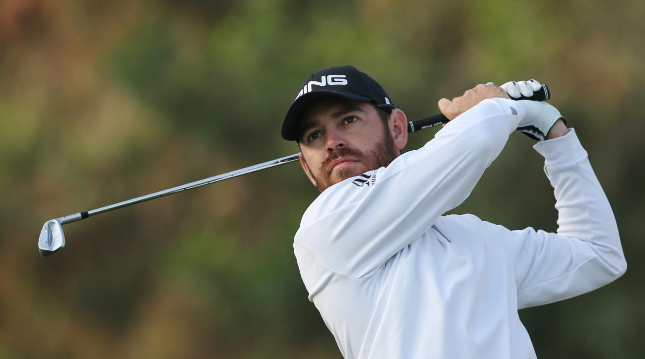 Louis Oosthuizen of South Africa plays a shot on the 11th hole during 1st round of the Omega Dubai Desert Classic golf tournament in Dubai, United Arab Emirates, Thursday, Feb. 4, 2016. (AP Photo/Kamran Jebreili)