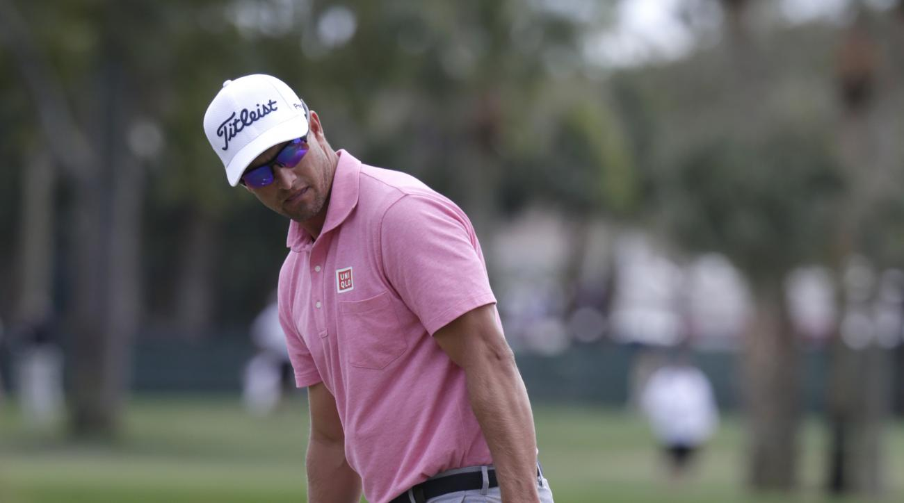 Adam Scott, of Australia, gestures for his ball to go in on the first hole during the fourth round of the Honda Classic golf tournament, Sunday, Feb. 28, 2016, in Palm Beach Gardens, Fla. Scott birdied the hole. (AP Photo/Lynne Sladky)