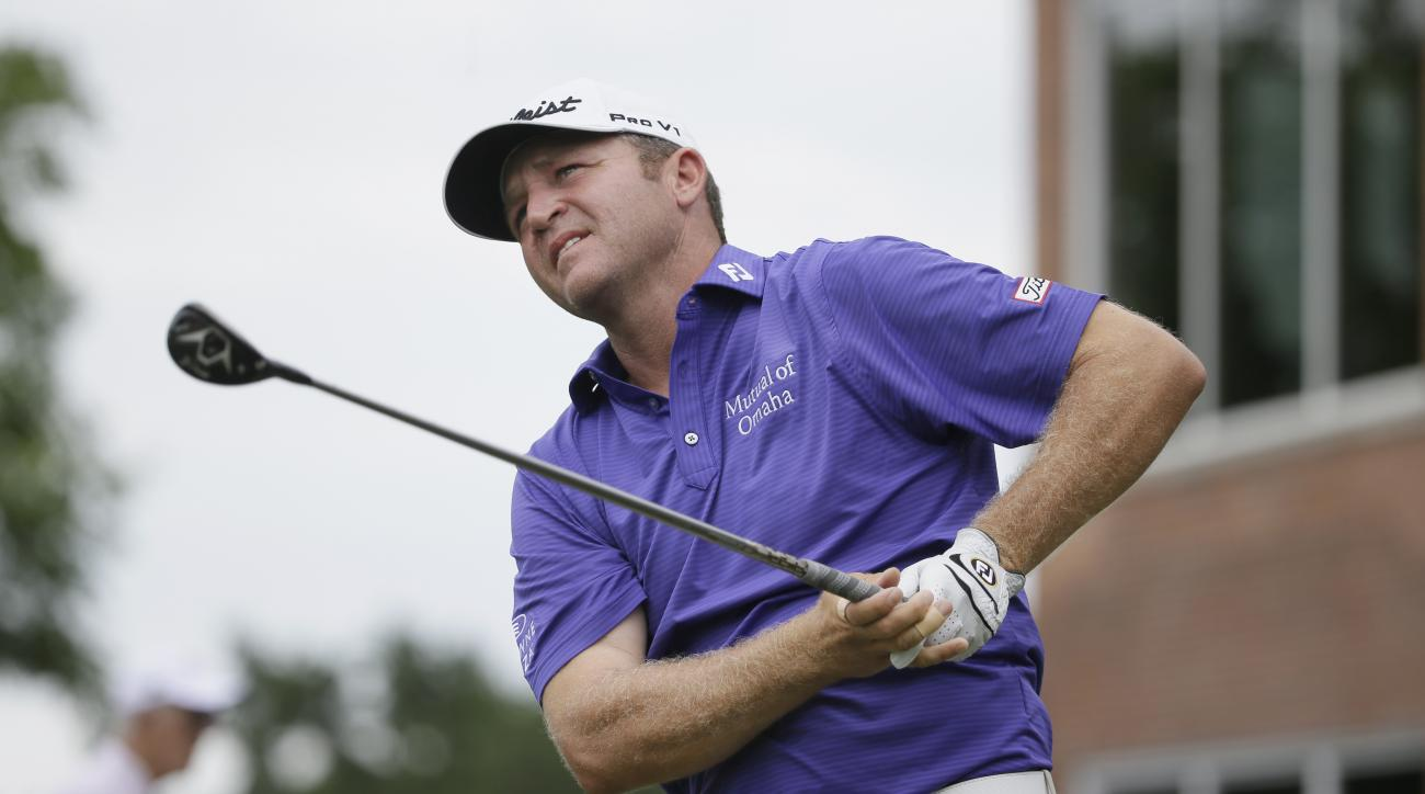 Jason Bohn watches his tee shot on the 17th hole during the final round of the Colonial golf tournament, Sunday, May 24, 2015, in Fort Worth, Texas. (AP Photo/LM Otero)