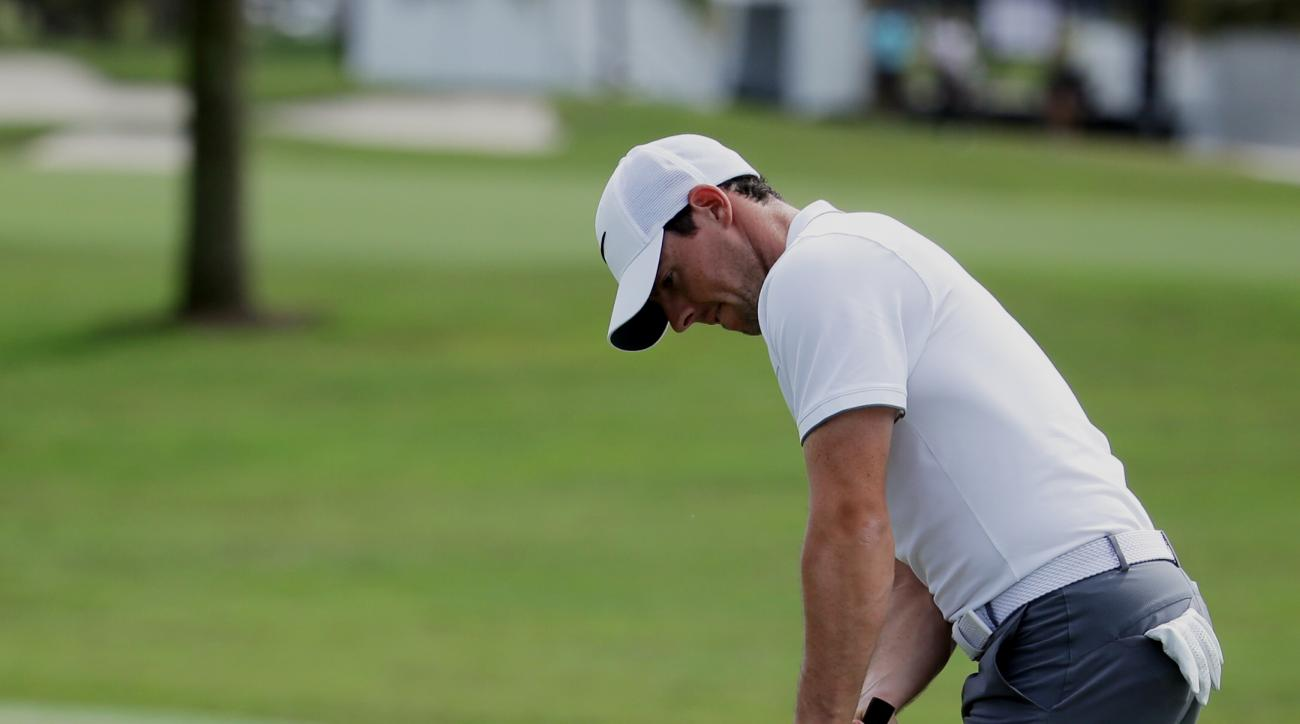 Rory McIlroy, of Northern Ireland, putts on the 10th green during the practice round of the Cadillac Championship golf tournament, Wednesday, March 2, 2016, in Doral, Fla. McIlroy, frustrated with his putting, has decided to go with a cross-handed grip fo