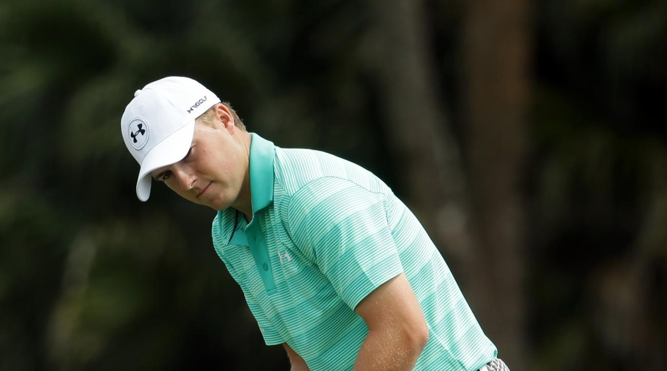 Jordan Spieth reacts to a missed putt on the 11th green during the first round of the Cadillac Championship golf tournament, Thursday, March 3, 2016, in Doral, Fla. (AP Photo/Lynne Sladky)