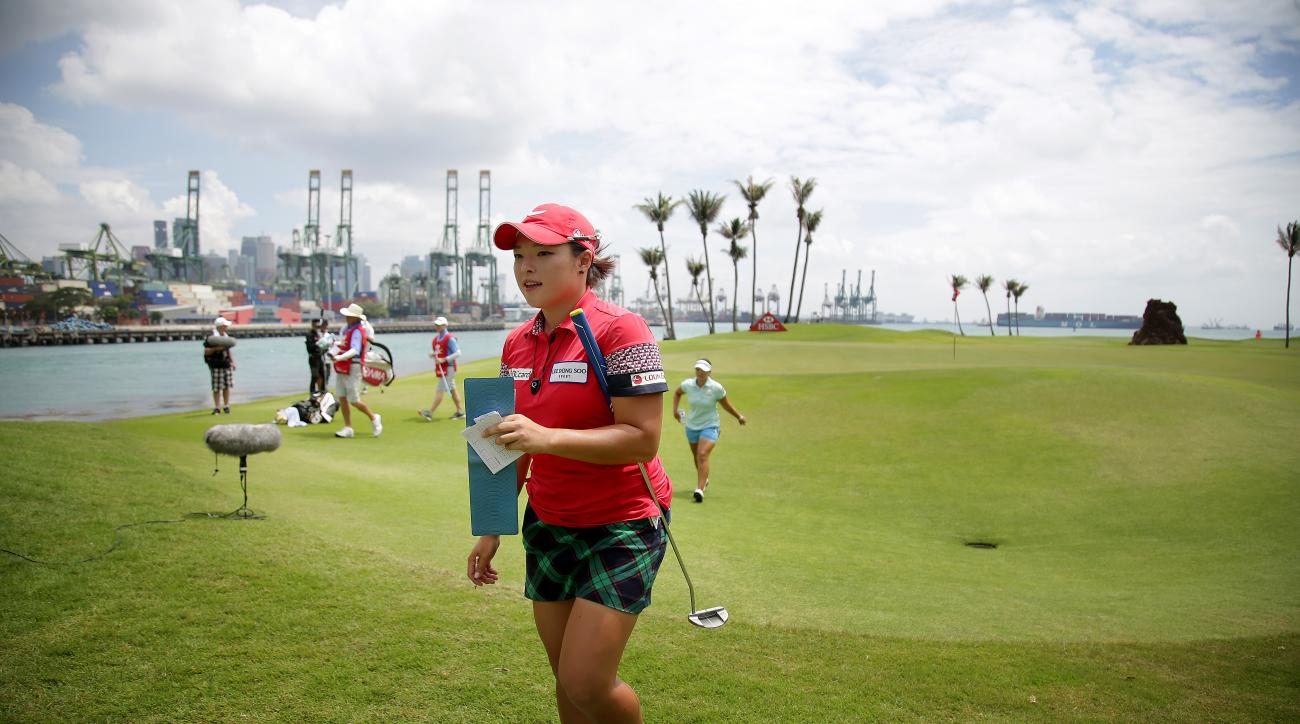 Jang Ha Na of South Korea walks off the 6th hole during the third round of the HSBC Women's Champions Golf tournament on Saturday, March 5, 2016, in Singapore. (AP Photo/Wong Maye-E)