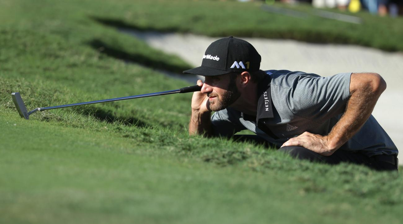 Dustin Johnson lines up his putt on the 12th green during the final round of the Cadillac Championship golf tournament, Sunday, March 6, 2016, in Doral, Fla. (AP Photo/Lynne Sladky)