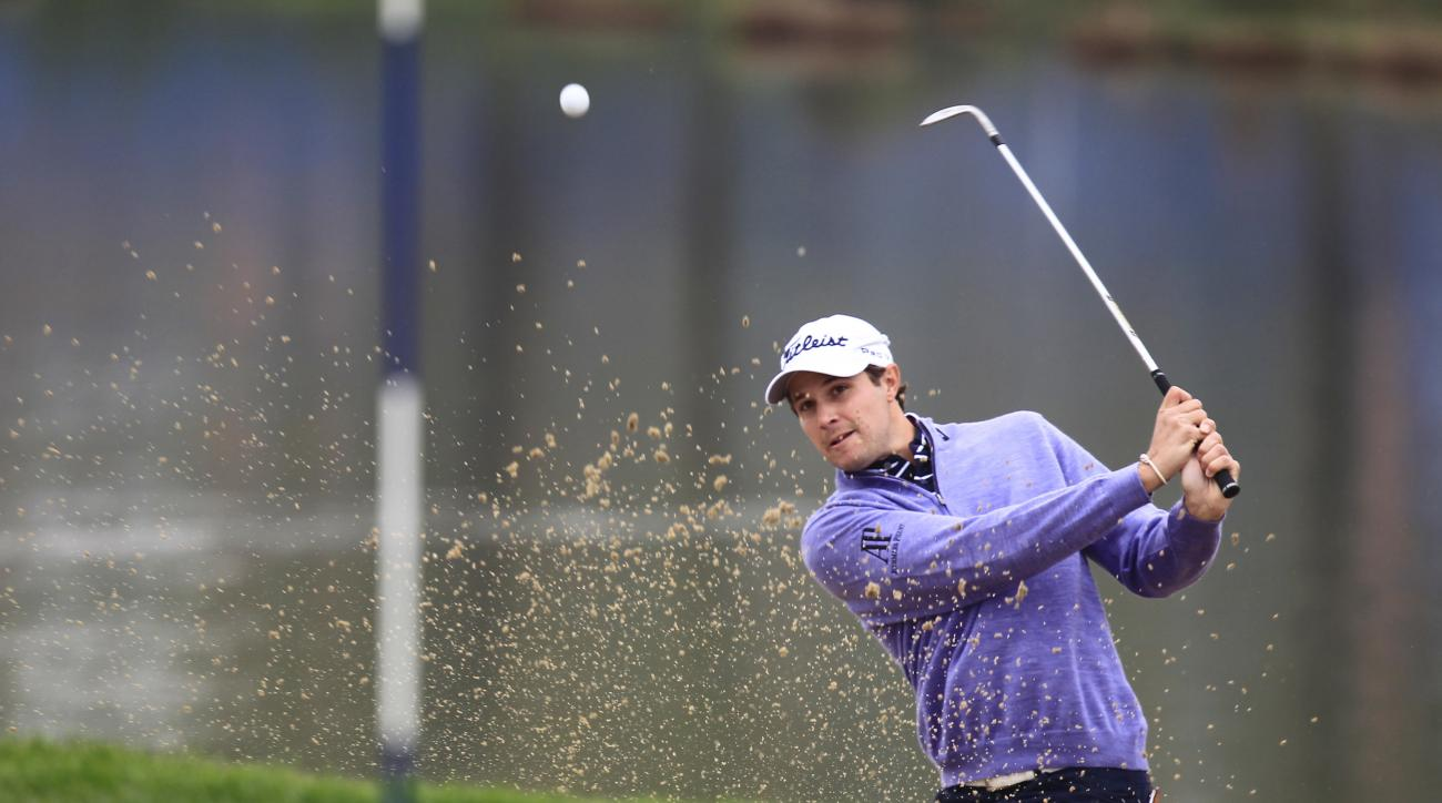 Peter Uihlein of the United States hits a shot from the bunker on the 8th hole during the second round of the BMW Masters golf tournament at the Lake Malaren Golf Club in Shanghai, China Friday, Nov. 13, 2015. (AP Photo)