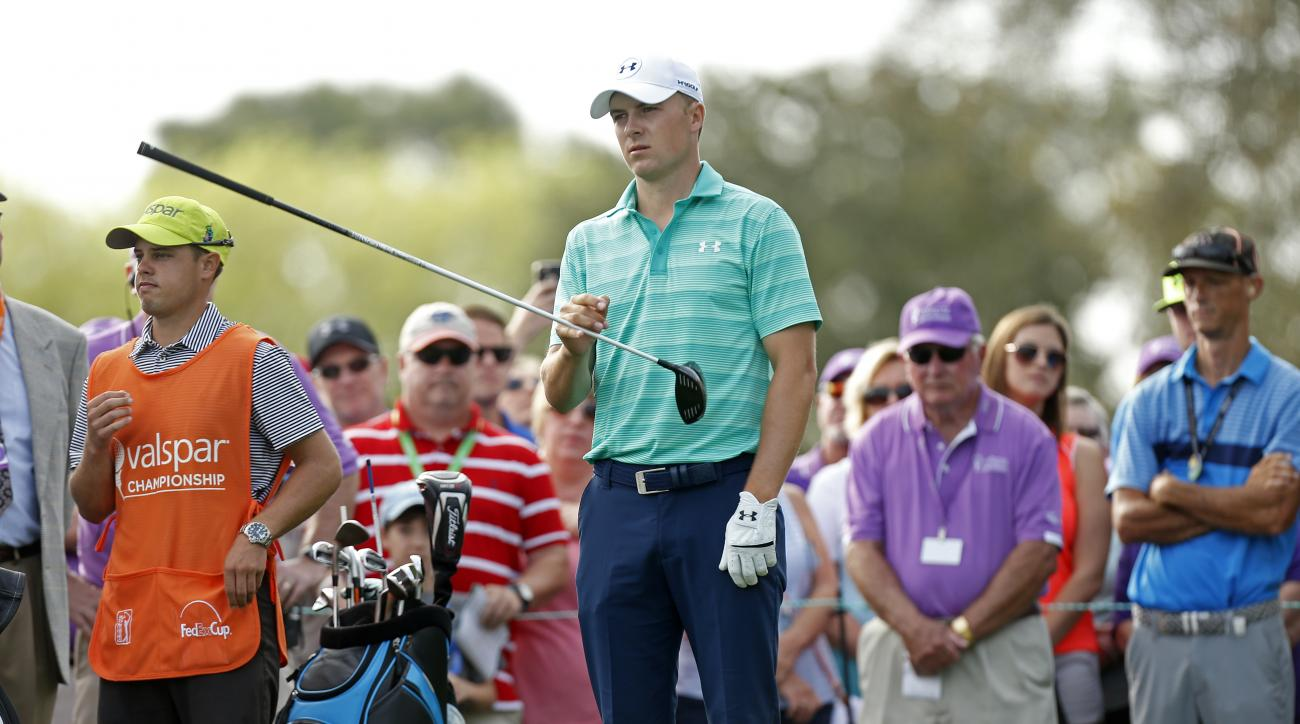 Jordan Spieth waits to hit his tee shot on the first hole during the third round of the Valspar Championship golf tournament Saturday, March 12, 2016, in Palm Harbor, Fla. (AP Photo/Brian Blanco)