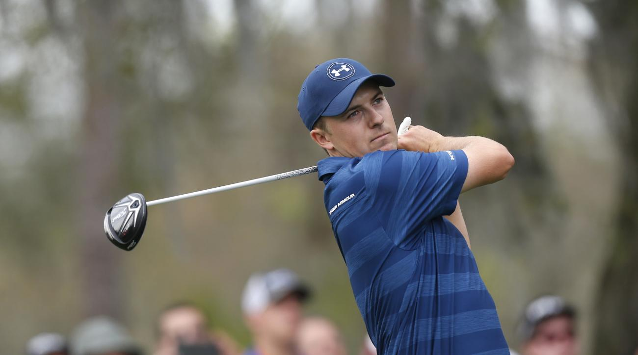 Jordan Spieth takes his tee shot in the second hole during the final round of the Valspar Championship golf tournament Sunday, March 13, 2016, in Palm Harbor, Fla. (AP Photo/Brian Blanco)