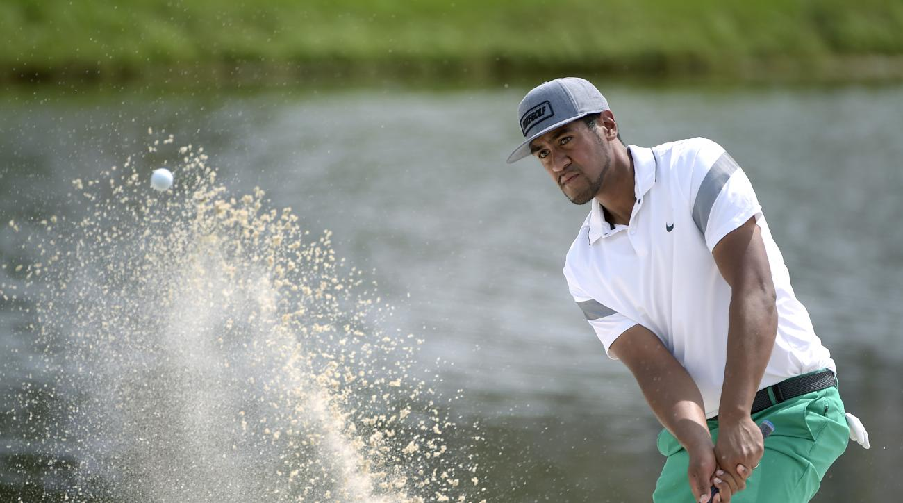Tony Finau hits out of a bunker onto the 17th green during the first round of the Arnold Palmer Invitational golf tournament in Orlando, Fla., Thursday, March 17, 2016. (AP Photo/Phelan M. Ebenhack)