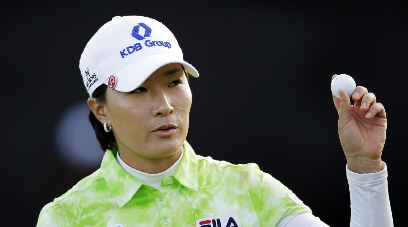 FILE - In this March 24, 2012, file photo, Se Ri Pak, of South Korea, picks up her ball after finishing the third round of the Kia Classic LPGA golf tournament in Carlsbad, Calif. Pak is retiring after the season, ending a Hall of Fame career that inspire
