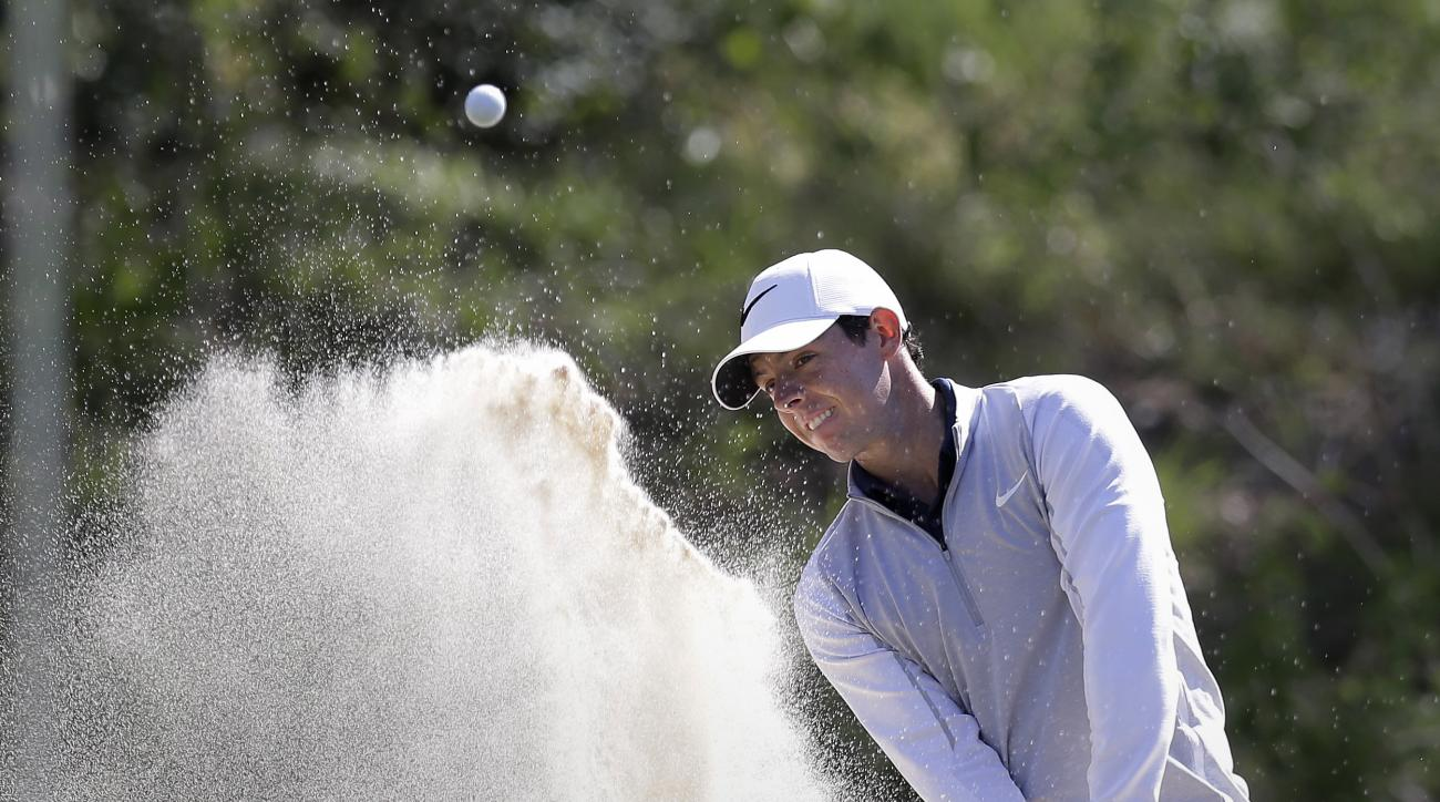 Defending champion Rory McIlroy, of Northern Ireland, hits from the sand on the seventh hole during practice for the Dell Match Play Championship golf tournament at Austin County Club, Tuesday, March 22, 2016, in Austin, Texas. (AP Photo/Eric Gay)