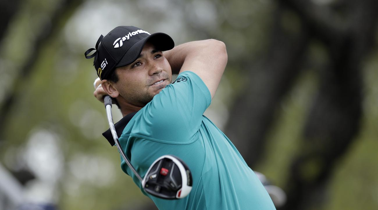 Jason Day of Australia watches his tee shot on the first hole during round-robin play against  Graeme McDowell at the Dell Match Play Championship golf tournament at Austin County Club, Wednesday, March 23, 2016, in Austin, Texas. (AP Photo/Eric Gay)