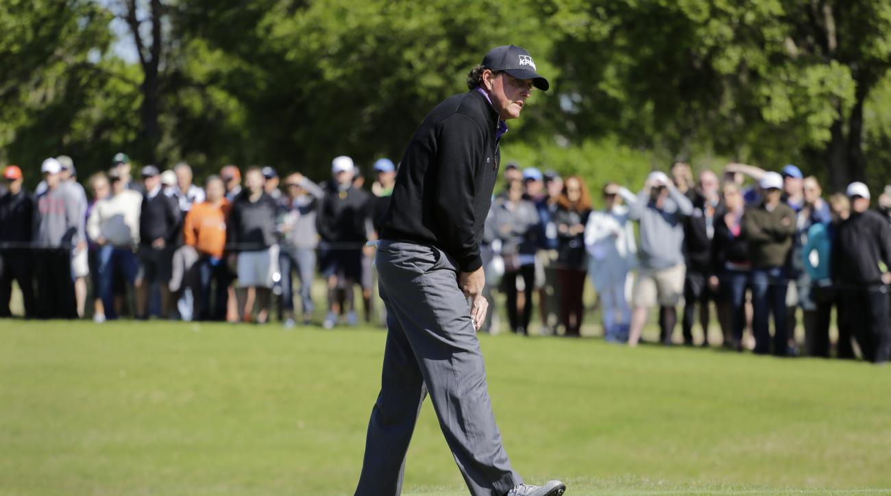 Phil Mickelson reacts to his putt on the first green during round-robin play against Daniel Berger at the Dell Match Play Championship golf tournament at Austin County Club, Thursday, March 24, 2016, in Austin, Texas. (AP Photo/Eric Gay)