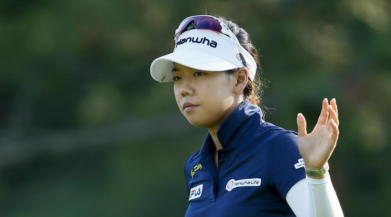 Jenny Shin acknowledges the gallery on the first green during the final round of the Marathon Classic golf tournament at Highland Meadows Golf Club in Sylvania, Ohio, Sunday, July 19, 2015. (AP Photo/Rick Osentoski)