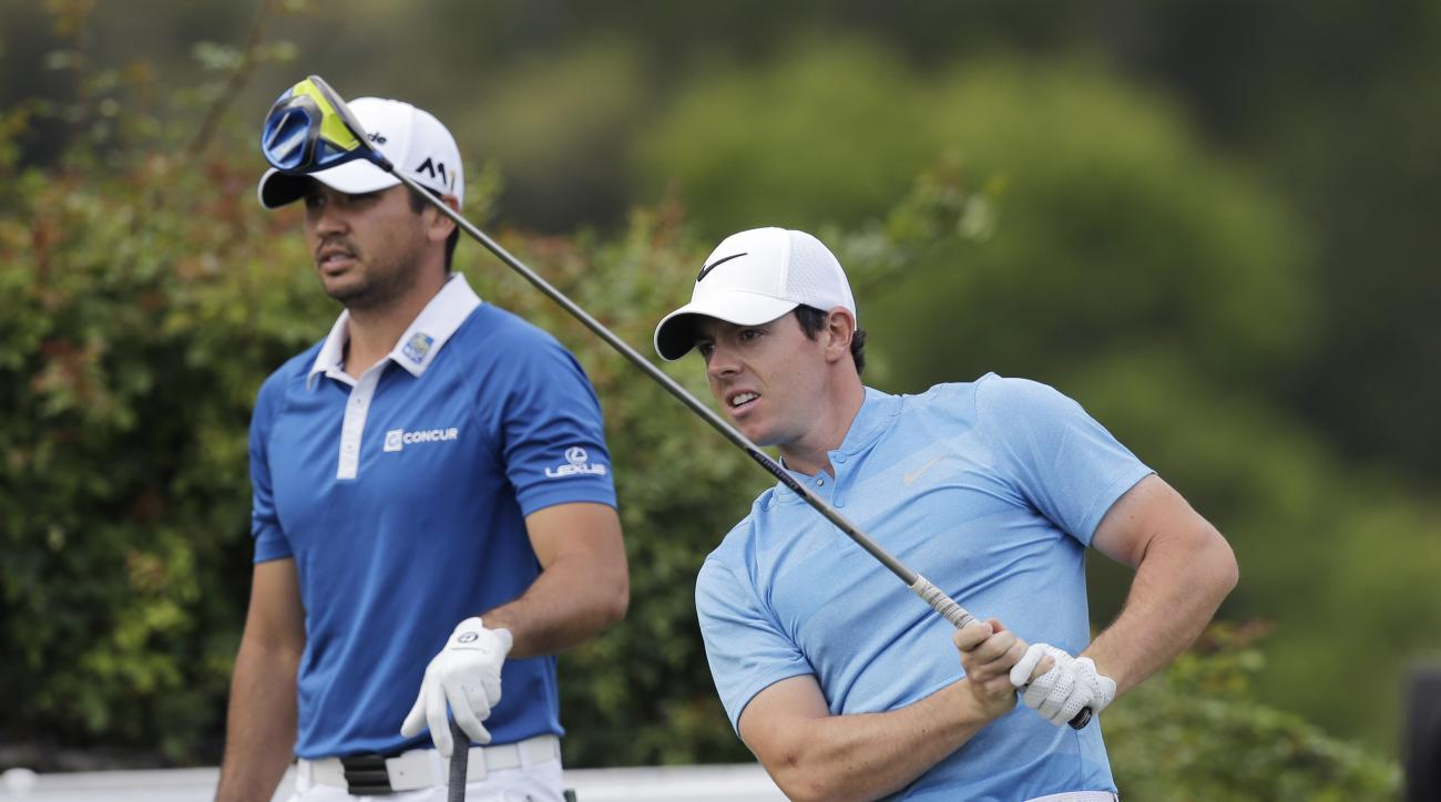 Rory McIlroy, of Northern Ireland, right, watches his tee shot as Jason Day, of Australia, left, watches on the sixth hole during the semifinal final round at the Dell Match Play Championship golf tournament at Austin County Club, Sunday, March 27, 2016,