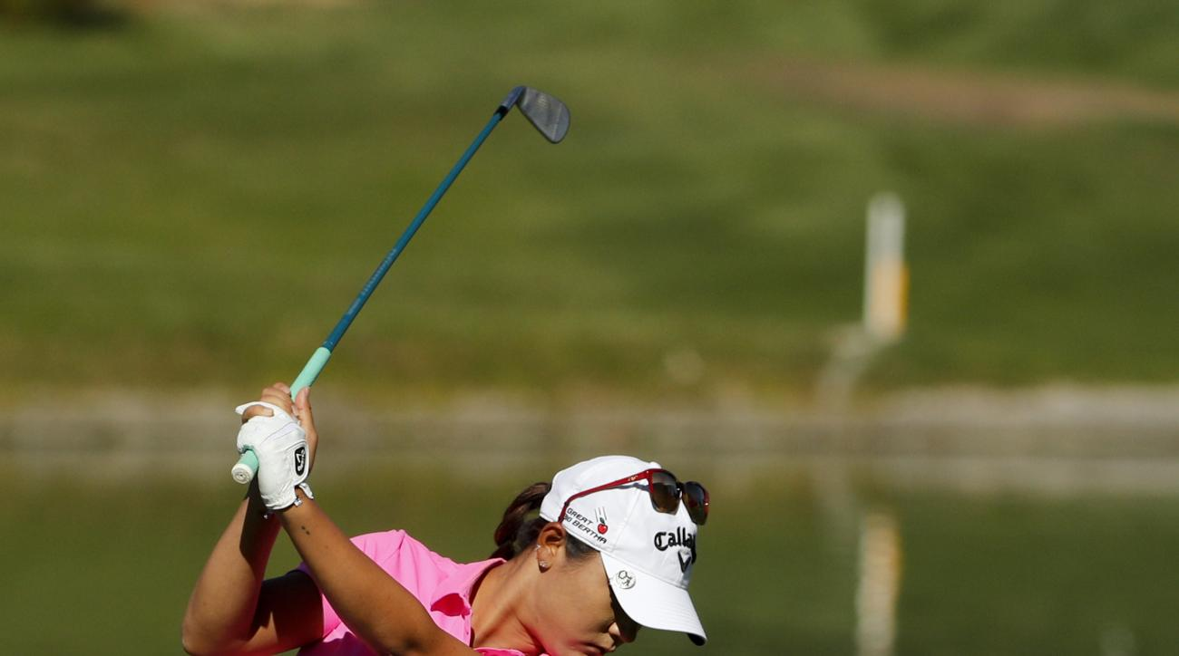 Lydia Ko, of New Zealand, hits from the fairway on the sixth hole during the first round of the LPGA Tour ANA Inspiration golf tournament at Mission Hills Country Club, Thursday, March 31, 2016 in Rancho Mirage, Calif. (AP Photo/Chris Carlson)