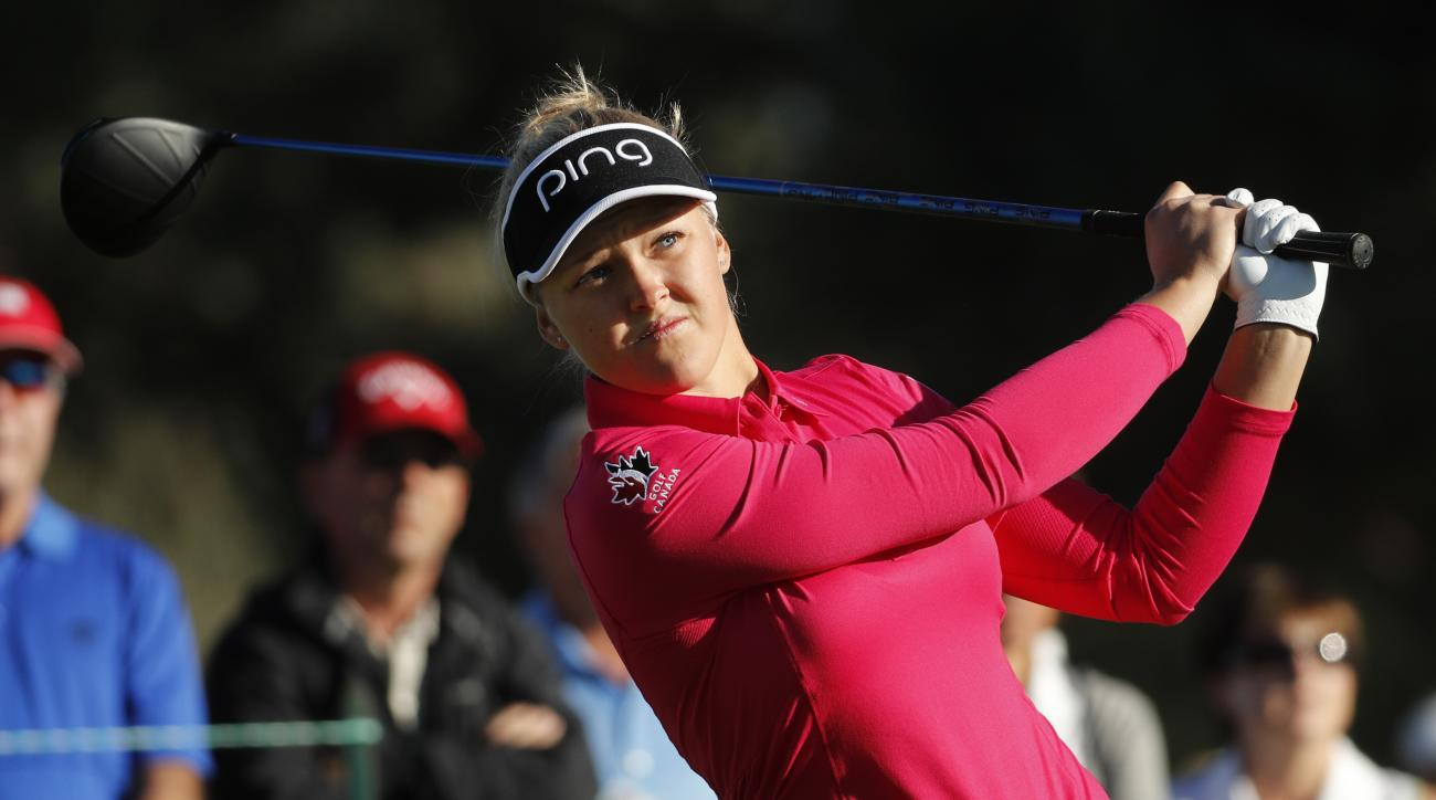 Brooke M. Henderson, of Canada, watches her tee shot on the second hole during the first round of the LPGA Tour ANA Inspiration golf tournament at Mission Hills Country Club, Thursday, March 31, 2016 in Rancho Mirage, Calif. (AP Photo/Chris Carlson)