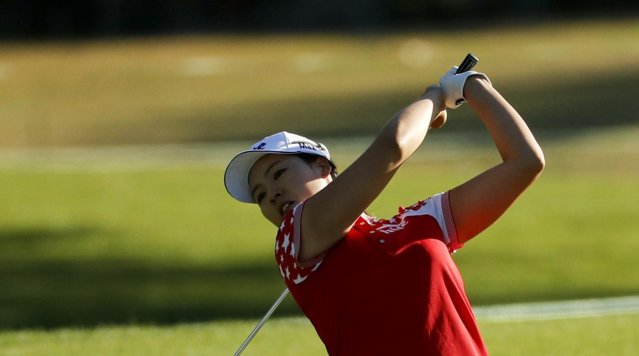 In Gee Chun, of South Korea, hits from the fairway on the first hole during the second round of the LPGA Tour ANA Inspiration golf tournament at Mission Hills Country Club, Friday, April 1, 2016 in Rancho Mirage, Calif. (AP Photo/Chris Carlson)