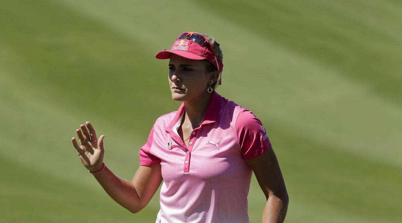 Lexi Thompson waves after a birdie on the second hole during the third round of the LPGA Tour ANA Inspiration golf tournament at Mission Hills Country Club, Saturday, April 2, 2016, in Rancho Mirage, Calif. (AP Photo/Chris Carlson)
