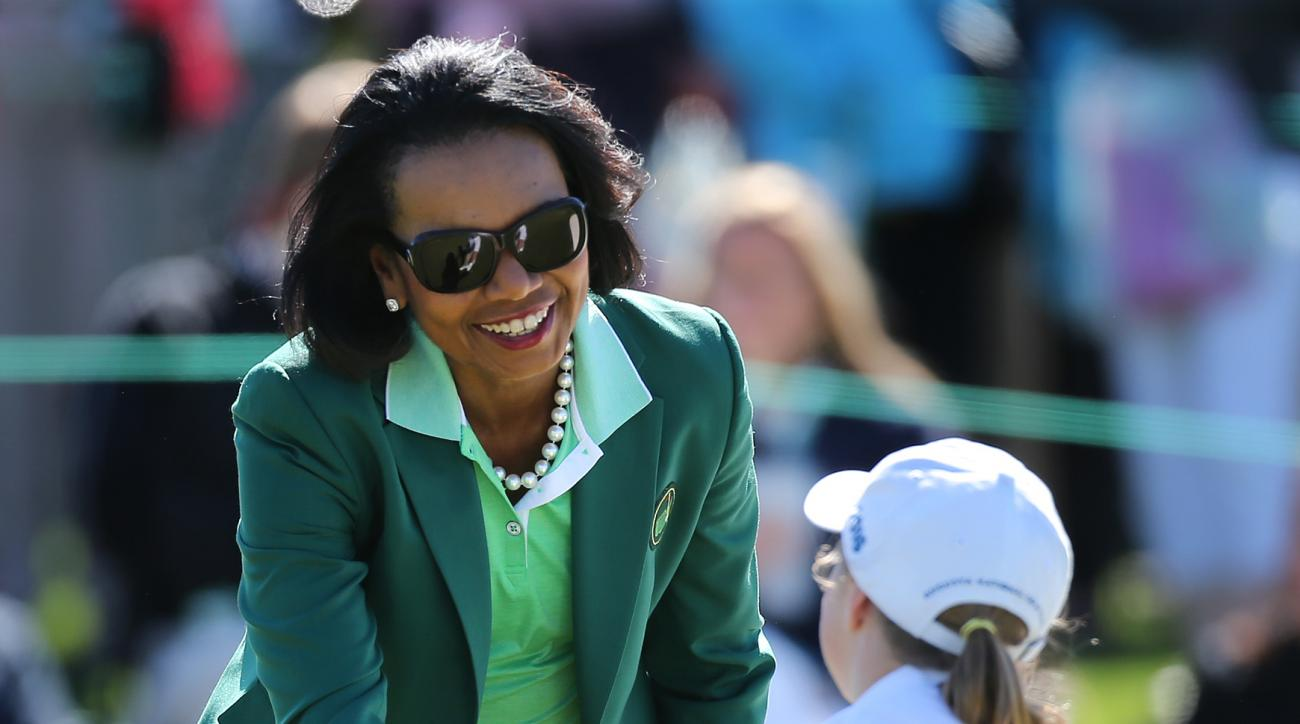 Former U.S. Secretary of State Condoleezza Rice shakes hands with Jayla Kucy after she putts out on the 18th green during the Drive, Chip, and Putt National Finals at Augusta National Golf Club on Sunday, April 3, 2016, in Augusta, Ga. (Curtis Compton/Atl