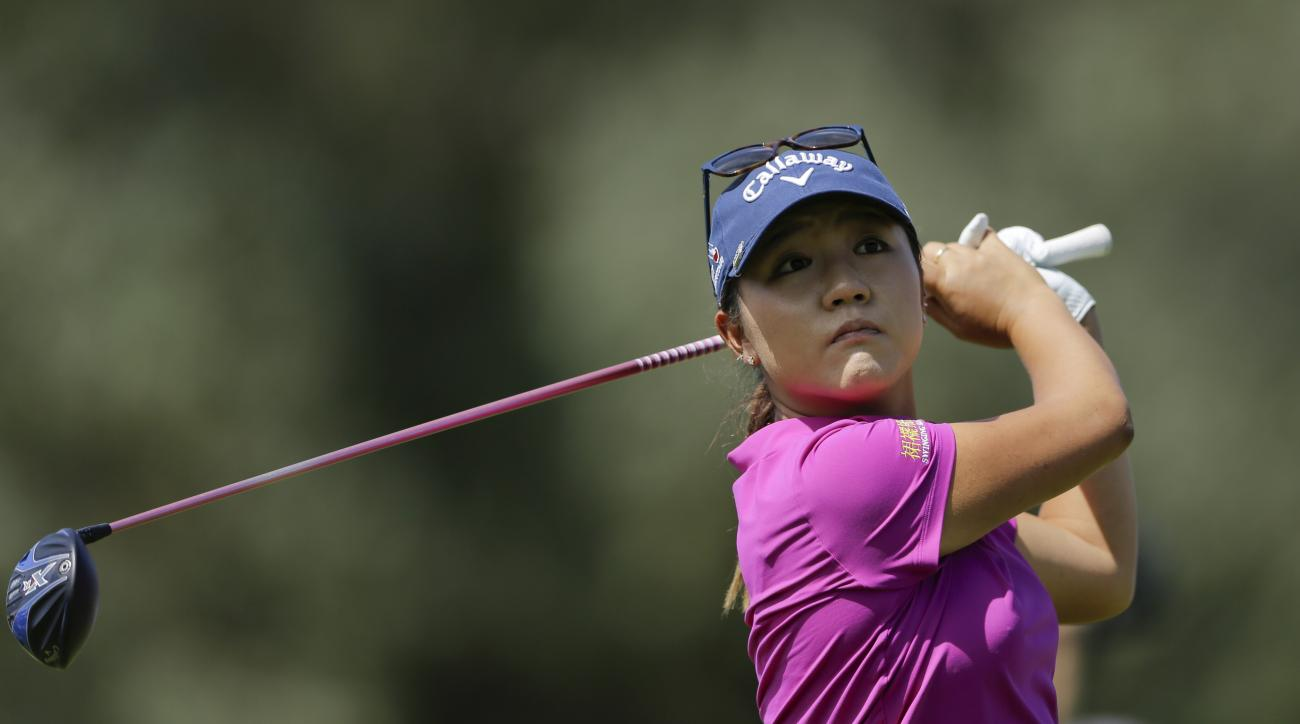 Lydia Ko, of New Zealand, watches her tee shot on the second hole during the final round of the LPGA Tour ANA Inspiration golf tournament at Mission Hills Country Club, Sunday, April 3, 2016, in Rancho Mirage, Calif. (AP Photo/Gregory Bull)