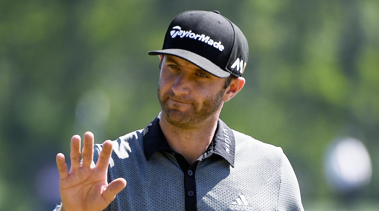 Dustin Johnson reacts after missing a putt for eagle on the 12th hole  during the final round of the Houston Open golf tournament, Sunday, April 3, 2016, in Humble, Texas. (AP Photo/Eric Christian Smith)