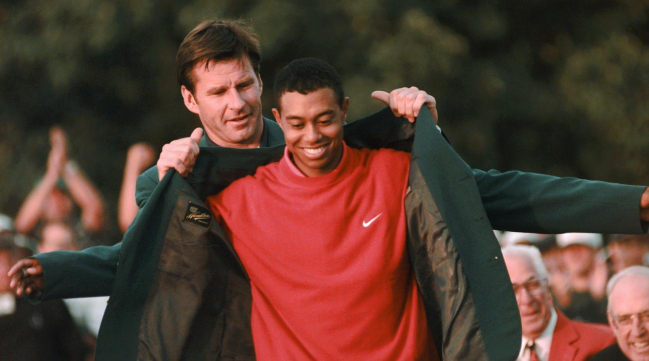 FILE - In this April 13, 1997 file photo, Masters champion Tiger Woods receives his Green Jacket from Nick Faldo at the Augusta National Golf Club in Augusta, Ga. Woods won the Masters by 12 shots, at the time the largest margin of victory in any major si