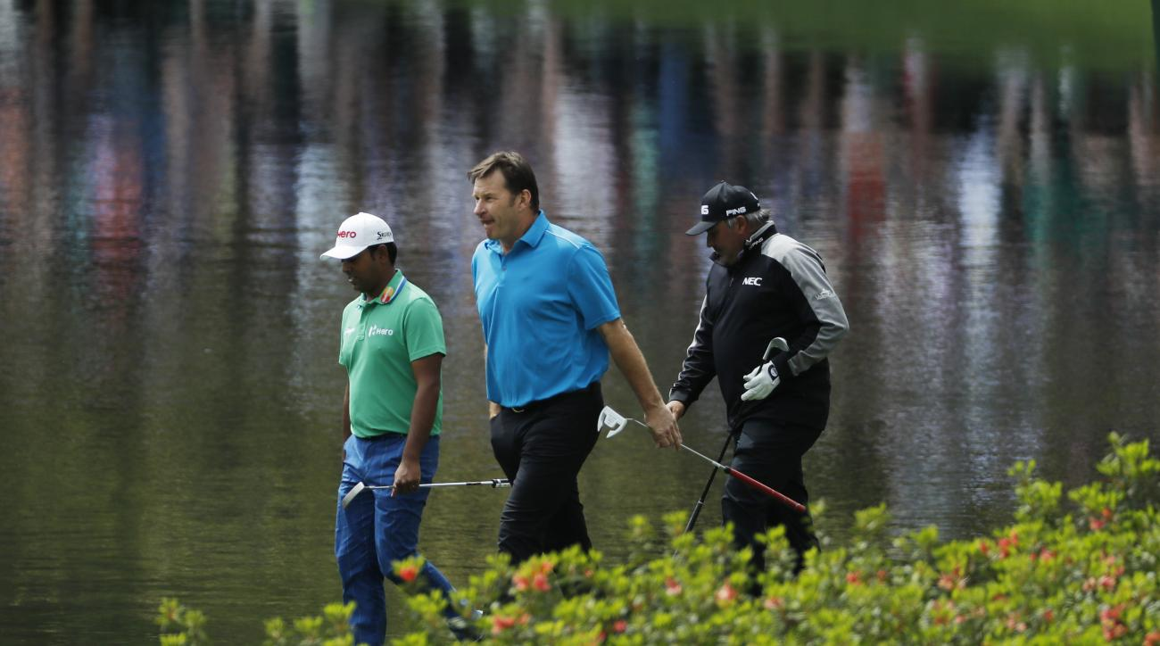 From left, Anirban Lahiri, of India, Nick Faldo and Angel Cabrera, of Argentina, walk to the eight hole during the par three competition at the Masters golf tournament Wednesday, April 6, 2016, in Augusta, Ga. (AP Photo/Matt Slocum)