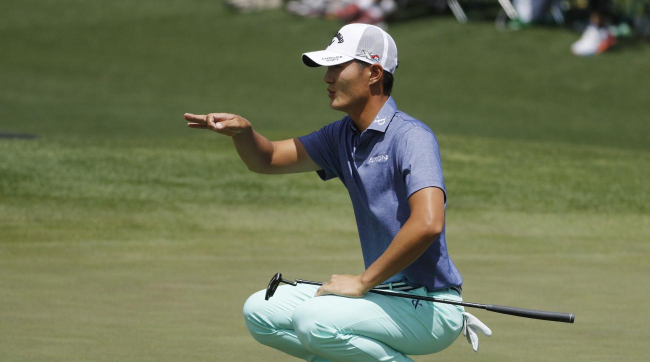 Danny Lee, of New Zealand, lines up his putt on the second green during the first round of the Masters golf tournament Thursday, April 7, 2016, in Augusta, Ga. (AP Photo/Chris Carlson)